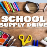The text School Supply Drive, over a brwon wooden table with pencils, watercolor paints, chalk, scissors, and more, spread around the text in a frame.